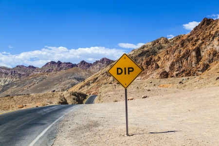 scenic road Artists Drive in Death valley with colorful stones, hills with minerals, , road sign DIP for hilly road photo