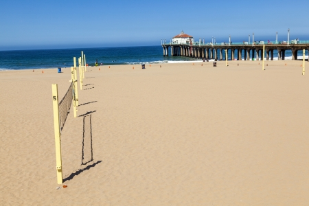 volleyball field at the beach with the pier in background