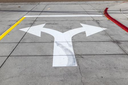 arrows and lines on the asphalt to indicate the direction of driving Stock Photo - 14528955