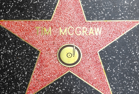 mcgraw: HOLLYWOOD - JUNE 26: Tim Mcgraws star on Hollywood Walk of Fame on June 26, 2012 in Hollywood, California. This star is located on Hollywood Blvd. and is one of 2400 celebrity stars.