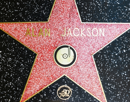 alan: HOLLYWOOD - JUNE 26: Alan Jacksons star on Hollywood Walk of Fame on June 26, 2012 in Hollywood, California. This star is located on Hollywood Blvd. and is one of 2400 celebrity stars. Editorial