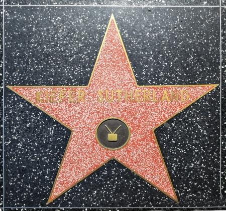 blvd: HOLLYWOOD - JUNE 26: Kiefer Sutherlands star on Hollywood Walk of Fame on June 26, 2012 in Hollywood, California. This star is located on Hollywood Blvd. and is one of 2400 celebrity stars.