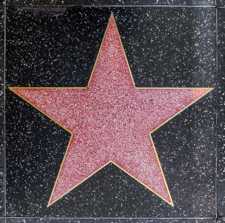 HOLLYWOOD - JUNE 26: empty star on Hollywood Walk of Fame on June 26, 2012 in Hollywood, California. This star is located on Hollywood Blvd. and is one of 2400 celebrity stars. Stock Photo - 14653955