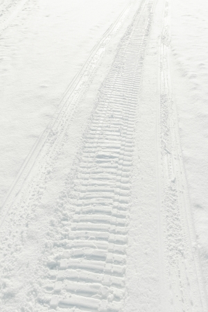 Trail of snow scooter wheel in fresh snow Stock Photo - 14674974