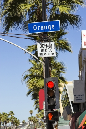 red traffic light: street sign Orange Drive  in Hollywood with red traffic light