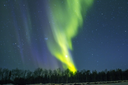 borealis: Northern Lights (Aurora borealis) over snowscape. Stock Photo