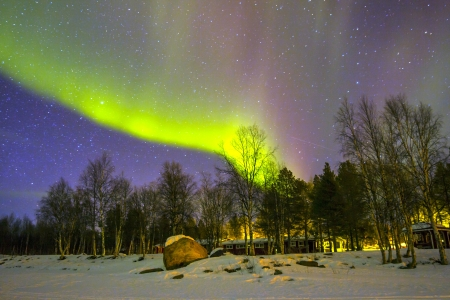 magnetic north: Northern Lights (Aurora borealis) over snowscape. Stock Photo