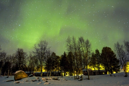 magnetosphere: Northern Lights (Aurora borealis) over snowscape. Stock Photo