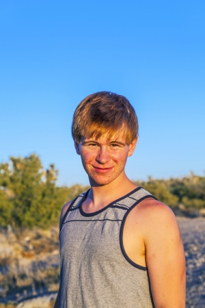 sunset with smiling attractive boy in Joshua tree landscape photo