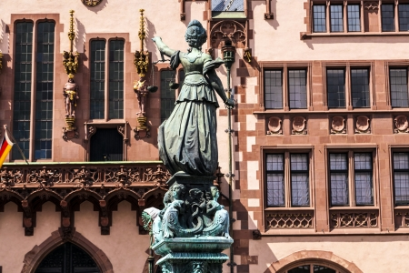 Statue of Lady Justice in front of the Romer in Frankfurt - Germany photo