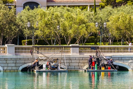 LAS VEGAS NV - JUNE 15: divers clean the lake of Luxury hotel Bellagio on June 15, 2012 in Las Vegas, USA.  The Bellagio opened October 15, 1998.