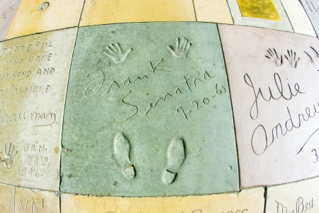 handprints: LOS ANGELES - JUNE 26:  handprints of Frank Sinatra in Hollywood Boulevard on June 26,2012 in Los Angeles. There are nearly 200 celebrity handprints in the concrete of Chinese Theatres forecourt.