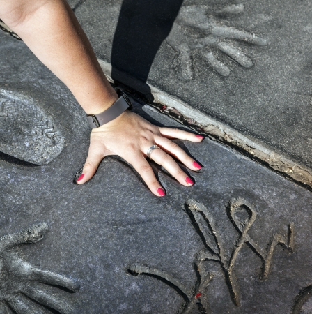 LOS ANGELES - JUNE 26:  fan puts hand in handprints of twilight saga stars on June 26,2012 in Los Angeles. There are nearly 200 celebrity handprints in the concrete of Chinese Theatres forecourt.
