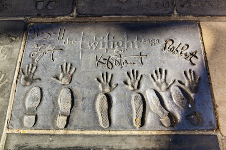 handprints: LOS ANGELES - JUNE 26:  handprints of Twilight saga stars in Hollywood Boulevard on June 26,2012 in Los Angeles. There are nearly 200 celebrity handprints in the concrete of Chinese Theatres forecourt. Editorial