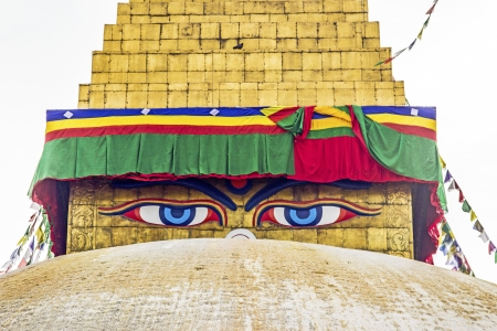 bodhnath stupa in kathmandu with buddha eyes and prayer flags with clear blue sky photo