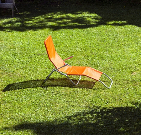 empty sun lounger in the garden photo