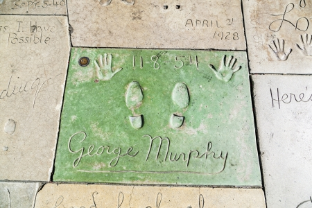 LOS ANGELES - JUNE 26:  George Murphys handprints in Hollywood Boulevard on June 26,2012 in Los Angeles. There are nearly 200 celebrity handprints in the concrete of Chinese Theatres forecourt.