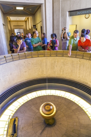 griffith: LOS ANGELES, CA - JUNE 10: people admire the Foucault pendulum in Griffith park on June 10,2912 in Los Angeles. The pendulum was installed in 1935  to demonstrate the rotation of the Earth.