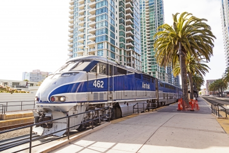 arrives: SAN DIEGO, USA - JUNE 11: train arrives at Union Station on June 11, 2012 in San Diego, USA. The Spanish Colonial Revival style station opened on March 8, 1915 as Santa Fe Depot.