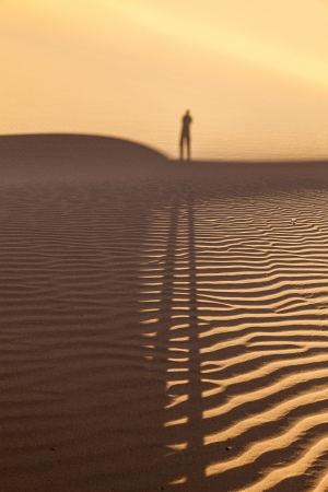 shadow of a man in the desert photo