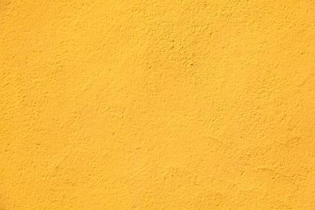 paredes exteriores: Textura de la pared amarilla para el fondo