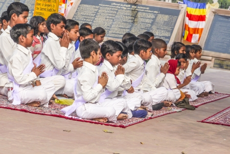 sarnath: VARANASI, INDIA - 11 DECEMBER: young children pray in tibetan buddhist monastery Sarnath in holy Varanasi, Uttar Pradesh, on December 11, 2011 in Varanasi, India. Editorial