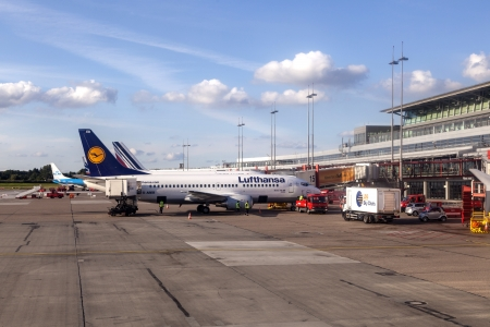 HAMBURG, GERMANY - SEP 3: Aircraft at the finger in the modern Terminal 2 on September 3, 2012 in Hamburg, Germany. Terminal 2 was completed in 1993 and houses Lufthansa and other Star Alliance partners. Stock Photo - 15079493