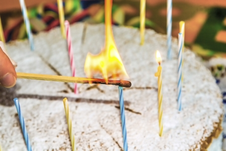 sweet seventeen: lighting the birthday candles on the cake Stock Photo
