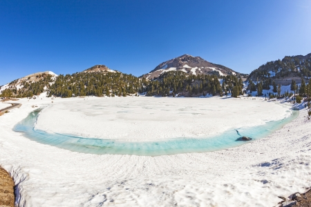 icy glacier lake on foot of Mount Lassen in the national park photo