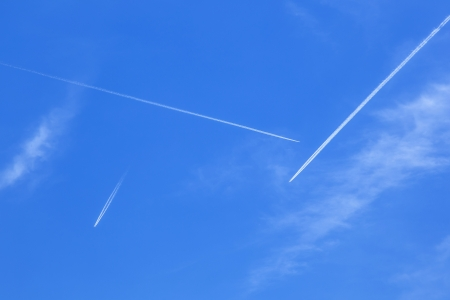 Deep blue sky with many  contrails photo