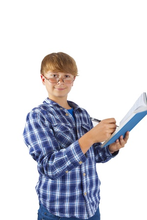 happy smart boy is reading in a book photo