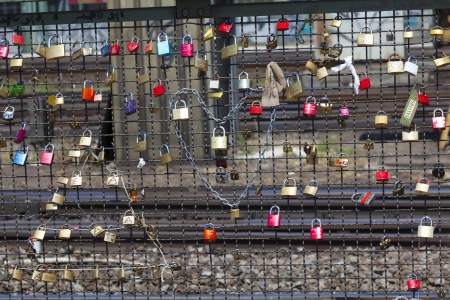 COLOGNE, GERMANY - MAY 11. lockers at the  Hohenzollern bridge symbolize love for ever on May 11,2011 in Cologne, Germany. It is the most heavily used railway bridge in Germany and used by pedestrians in love.