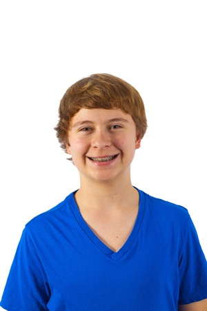 smart happy young boy posing in studio photo