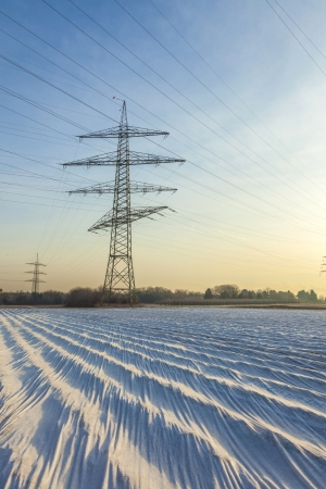 electrical tower in rural landscape with fields in foil photo