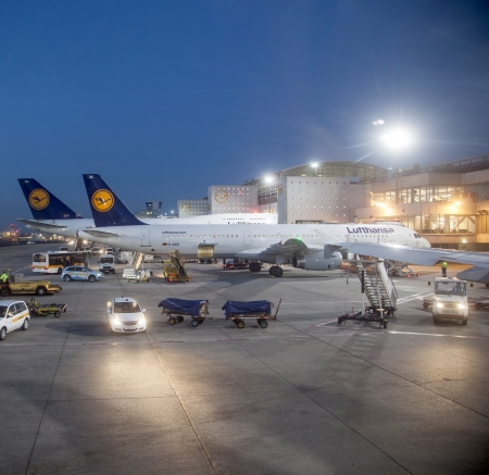 FRANKFURT, GERMANY - MARCH 16: Lufthansa Flight at the gate for morning flight on August, 25, 2011 in Frankfurt, Germany. New Terminal A is under construction for airport enlargement.
