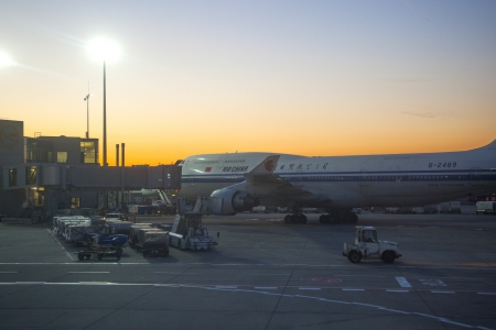 FRANKFURT, GERMANY - MARCH 16: Air China Flight at the gate for morning flight on August, 25, 2011 in Frankfurt, Germany. New Terminal A is under construction for airport enlargement.