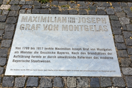 graf: MUNICH, GERMANY - JULY 09 : plate of sculpture of Graf Maximilian Joseph von Montegelas, a reformer of bavarian state at July 09, 2011 in Munich, Germany. The sculpture from Karin Sander was inaugurated in 2005.