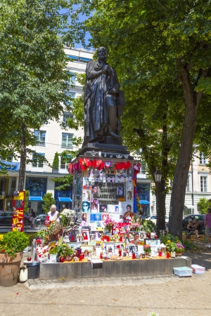 michael jackson: MUNICH, GERMANY - JULY 09 : people remember Michael Jackson with post cards and personal letters at the statue of Orlando di Lasso on July 09,2011 in Munich, Germany. Jackson died on June 25,2009 in Los Angeles.