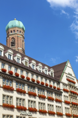 MUNICH, GERMANY - JULY 9: Exterior view of Hirmer, the largest mens fashion house in the world, with decoration on July 9,2011 in Munich, Germany