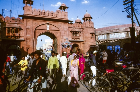 bikaner: BIKANER, INDIA, OCTOBER 15: People pass the gate to the  Junagarh Fort in red sandstone on October 15,2007 in Bikaner, India. The Fort was designed by Sir Swinton Jacob for Maharaja Ganga Singh almost 90 years ago.