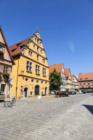mentioned: DINKELSBUEHL, GERMANY - JULY 22: historic timbered houses on July 22,2011 in Dinkelsbuehl, Germany.  First mentioned in 1188, the City was never destroyed and still stays in the historic architecture. Editorial