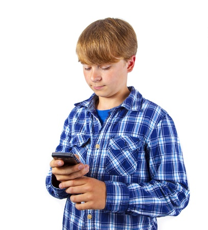 cute handsome young boy speaking a mobile phone Stock Photo - 15770363