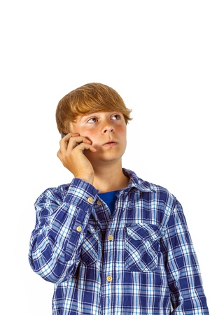 cute handsome young boy using his mobile phone Stock Photo - 15770376