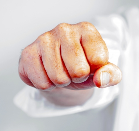 detail of male fist in white business shirt photo