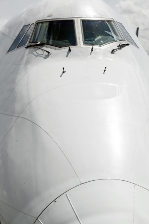 detail of aircraft nose with cockpit window photo