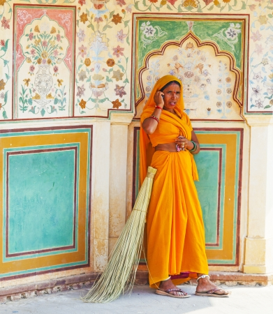 AMER, INDIA - 19 NOVEMBER: woman of fourt class in brightly colored sari clean the Amber palace on November 19,2012 in Amer,India. They earn 300 IRP for two hours paid by the government.