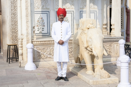 greet eyes: JAIPUR, INDIA - OCTOBER 19: Indian welcome from unidentified guard in typical indian dress of the City Palace on October 19, 2012 in Jaipur, Rajasthan, India.