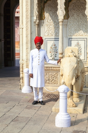 JAIPUR, INDIA - OCTOBER 19: Indian welcome from unidentified guard in typical indian dress of the City Palace on October 19, 2012 in Jaipur, Rajasthan, India.