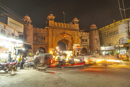 bikaner: BIKANER, INDIA - OCTOBER 23: people pass the ancient gate  by night  on October 23, 2012 in Bikaner, India. The Kote Gate was closed after sunset till sun rise during Maharaj Ganga Singh.