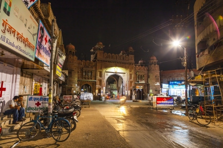 bikaner: BIKANER, INDIA - OCT 23: people pass the ancient gate  by night  on October 23, 2012 in Bikaner, India. The Kote Gate was closed after sunset till sun rise during Maharaj Ganga Singh. Editorial